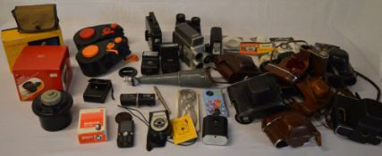Quantity of photography accessories including flash units, camera cases,