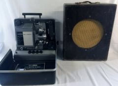 Bell & Howell film projector with cabinet speaker & film spool