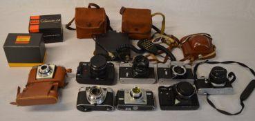 Various vintage cameras including Zenit, Kodak,