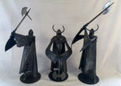 Group of 3 large steel helmeted warriors by sculptor Ron Lyon.