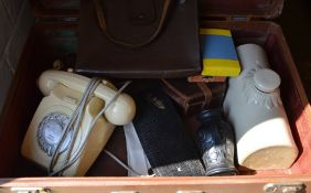 Suitcase of mixed items including retro rotary telephone,