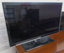 Samsung LED TV with remote control and instruction manual