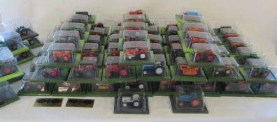 Large collection of approximately 142 Hatchette die cast tractors complete with magazines (in