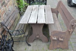 2 patio benches and a table