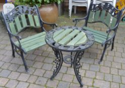 Cast iron & wood pair of garden chairs and table