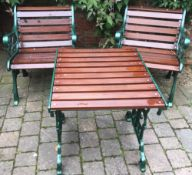 2 cast iron & wood chairs & a table