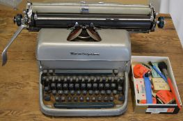 Remington typewriter and a quantity of typewriter accessories including ribbons and cleaning