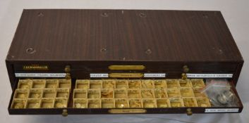 Watchmakers cabinet full of mainly watch crystals and some military watch parts