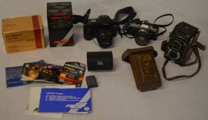 Vintage cameras and lenses including a Yashica C, Olympus OM-10,