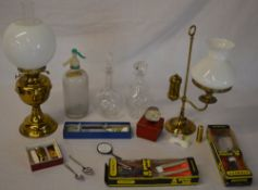 Mixed lot including decanters, soda syphon, garden tools, paperweight,
