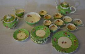 Green & white floral decorated part tea service (AF)