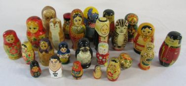 Collection of wooden Russian dolls and other stacking dolls and animals