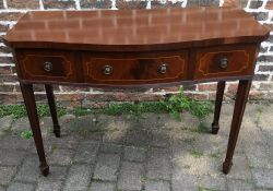 Regency style bow fronted sideboard on tapering legs with spade feet
