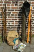 Fishing basket, fishing reels and books,