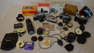 Various vintage cameras and accessories including Asahi Pentax, Praktica PLC3, various filters,