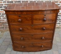 Victorian bow fronted chest of drawers with mahogany veneer,