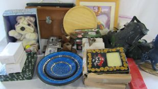 2 boxes of assorted items inc prints, roller blades, musical novelty dog,