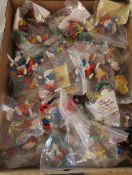 Box of loose McDonalds Smurf figures