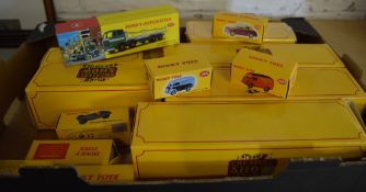 Box of various Atlas 'The Greatest Show on Earth' vehicles and various boxed reproduction Dinky