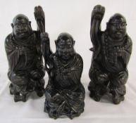 3 carved ebony buddha style figures 30 cm and 23 cm
