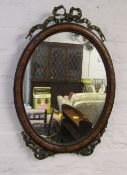 Ornate oval mirror with gilded ribbon embelishments
