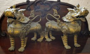 A large pair of ornate brass foo dogs / Chinese guardian lions