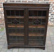 Display cabinet with leaded glass panels