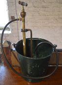 Vintage metal bucket and Four Oaks brass pump