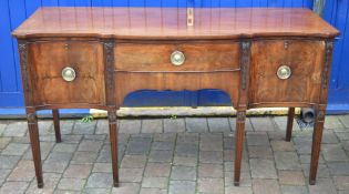 George III serpentine front mahogany sideboard on tapering fluted legs with Adam style carved