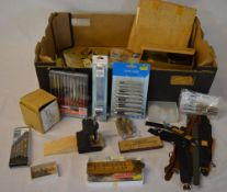 Various watchmakers repair tools including files, drill bits, small vice,