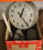 Various tools including a large adjustable spanner, large wall clock,