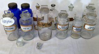Various glass chemists bottles & jars in a wicker basket