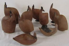 Box of carved wooden birds