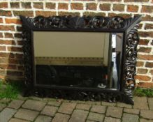 Ornately carved oak wall mirror 122 cm x 90 cm