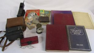 Assorted books relating to Royalty, Brownie box camera, pair of old glasses,