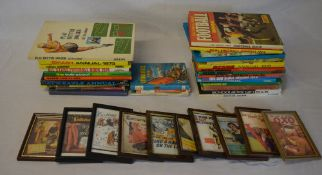Quantity of annuals and small framed prints