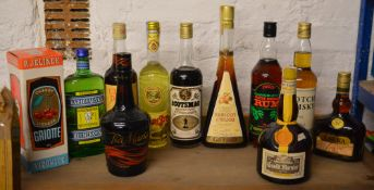 11 bottles of alcoholic drinks including Tia Maria, Scotch Whisky, Cherry Liqueur,