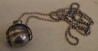 Taxco Italian silver expandable photograph locket on a silver chain,