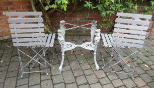 Cast iron table base and 4 folding patio chairs