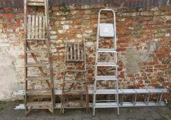 3 step ladders & an extending ladder