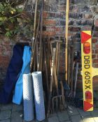Assorted garden tools, folding chairs,