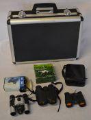 6 pairs of binoculars and a cased Tamashi camera kit