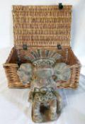 Mexican terracotta figure & a wicker picnic basket