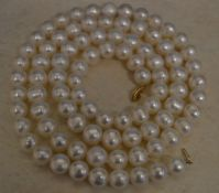 Large cultured pearl necklace with a 10kt gold clasp,