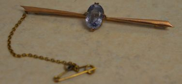 9ct gold bar brooch with safety chain, set with a single blue gemstone, possibly aquamarine,