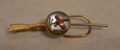 Ornate 14kt gold reverse intaglio tie clip shaped as a double barrel hunting shotgun,