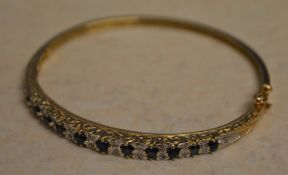 9ct gold sapphire and diamond bangle, set with approx 0.11ct of diamonds, total approx weight 11.