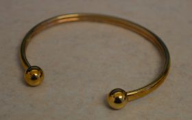 9ct gold torque bangle, total approx weight 3.