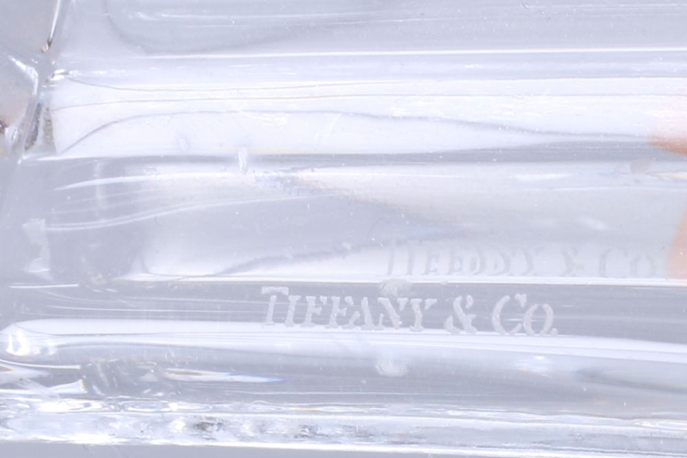 """Lot 49 - A pair of mid 20th century Tiffany & Co hexagonal glass candlesticks, 8"""" high"""
