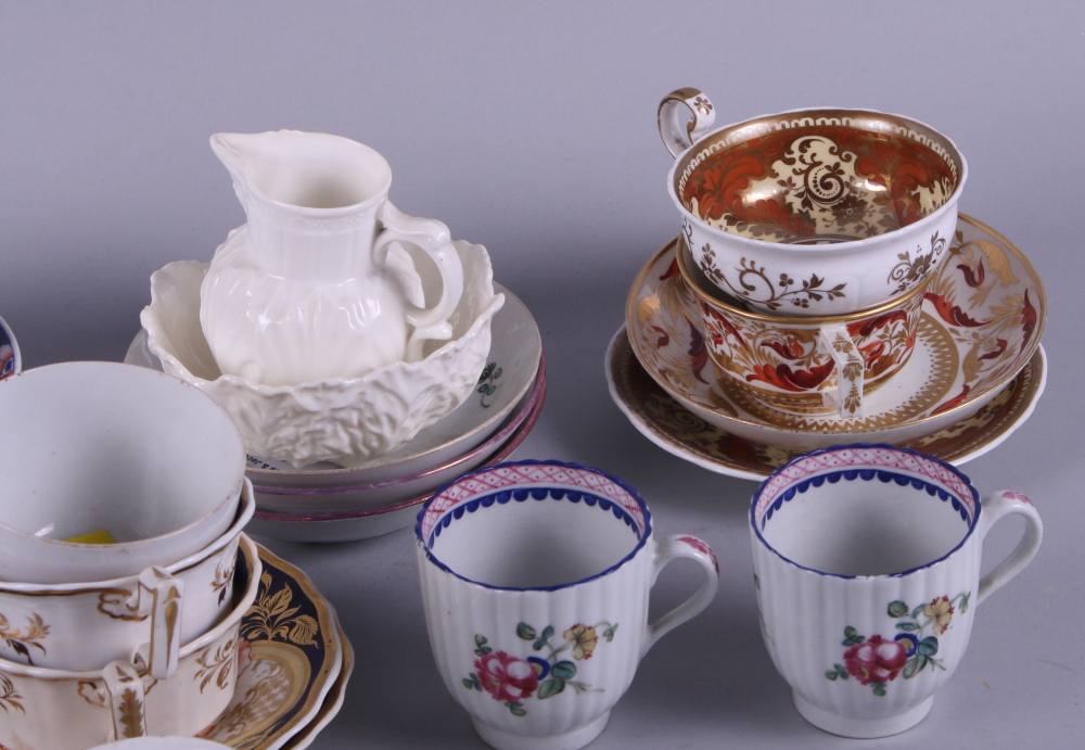 Lot 15 - A collection of English 18th and 19th century porcelain cabinet cups and saucers, various